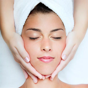 Woman receiving a relaxing facial at Skin and Acne Specialist