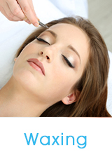 Woman relaxing with a waxing treatment at Skin and Acne Specialist